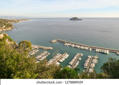Panoramic view from above of the harbor of Alassio, the Gallinara Island and the coastal city of Albenga in the background, Liguria, Italy