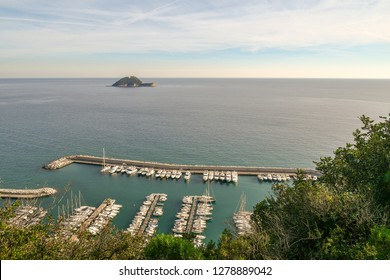 Panoramic view from above of the harbor of Alassio and the Gallinara Island, Liguria, Italy