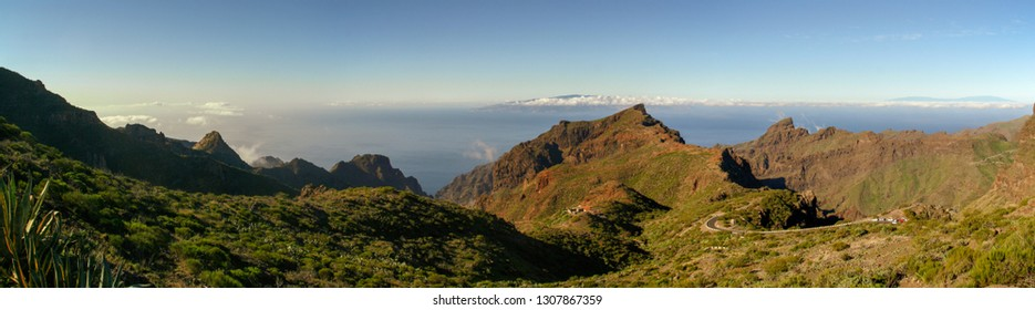 Panoramic View of the abrupt Masca ravine in the south of the Tenerife island, Canary islands, Spain. La Palma and La  Gomera islands at the background.