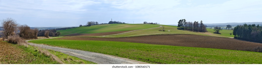 panoramic view across hills of a spring landscape with way at Bath Tatzmannsdorf, South Burgenland, Austria