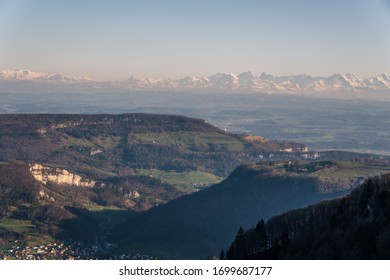 Panoramic view across Swiss Alps from Jura mountains with light haze but good visibility