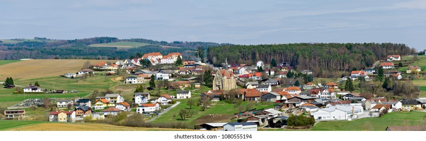 "panoramic view across the village of Mariasdorf with the famous parish church ""Assumption of Mary"", Burgenland, Austria"