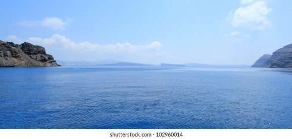 Panoramic view of aegean sea in the cyclades and the volcano from Thirassia island, Greece