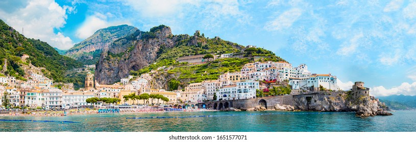 Panoramic view, aerial skyline of small haven of Amalfi village with tiny beach and colorful houses, located on rock, Amalfi coast, Salerno, Campania, Italy - Shutterstock ID 1651577071