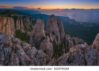 Panoramic view of Ai-Petri cliffs. Crimean nature. Memorial cross on top. Dawn. Republic of Crimea.
