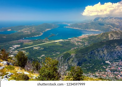 Panoramic view of the airport runway near the city, on the Adriatic Sea, from a great mountain height. Aerial view of Tivat, Kotor Bay, Montenegro.