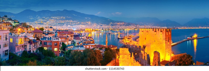 Panoramic view of Alanya harbour at night. Alanya, Turkey