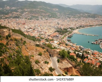 Panoramic view of Alanya, nautical vessels in the harbor and Alanya Castle fortress wall. Alanya, Antalya, Turkey