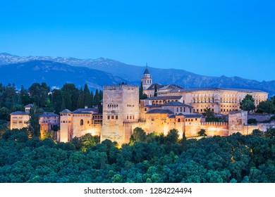 panoramic view of Alhambra during the sunset of a sunny day with the snowy mountains as background