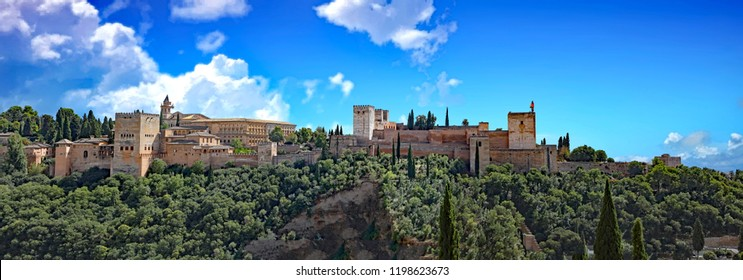 Panoramic view of the Alhambra Palaces and Generalife Gardens in Granada, Spain, a popular tourist attraction.