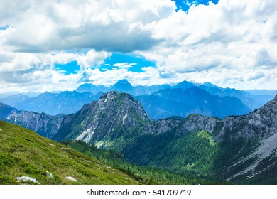 Panoramic view of Alps mountains in summer. Great view of beautiful landscape. Blue sky with clouds. Hermagor, Carinthia. Austria.