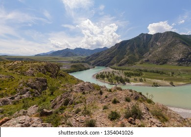 Panoramic view of an Altai mountain Katun river. Place of confluence of Katun and Chuya rivers. Summer time.