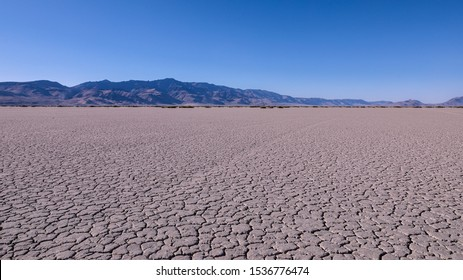 Panoramic view at Alvord desert with Steens mountains in the background. View of cracked Alvord Lake playa.