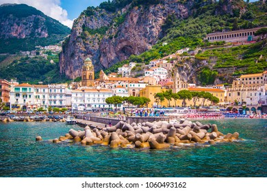 Panoramic view of  Amalfi Mediterranean coast, small town with multicolor houses, dock and old church in southern Italy, Gulf of Salerno, Campania