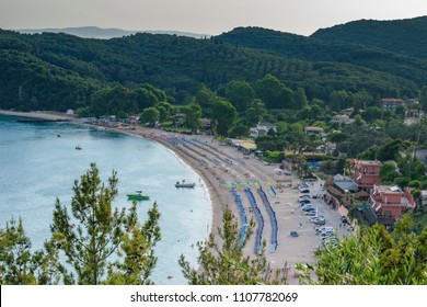 Panoramic view of the amazing beach of Valtos at sunset. It is one of the longest beaches in the coatal town of Parga, Greece, located near the historical castle of Parga.