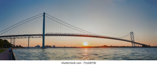 Panoramic view of Ambassador Bridge connecting Windsor, Ontario to Detroit Michigan at sunset