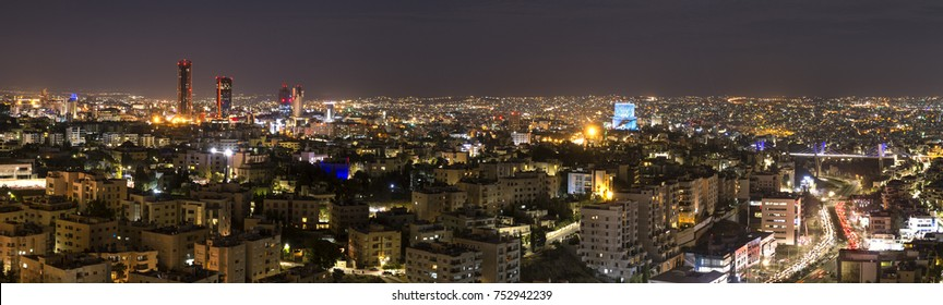 Panoramic view of Amman city at night - Amman skyline at night from abdali area to abdoun bridge
