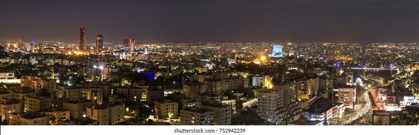 Vista panorámica de la ciudad de Amán por la noche - horizonte de Ammán por la noche desde el área de abdali hasta el puente abdoun