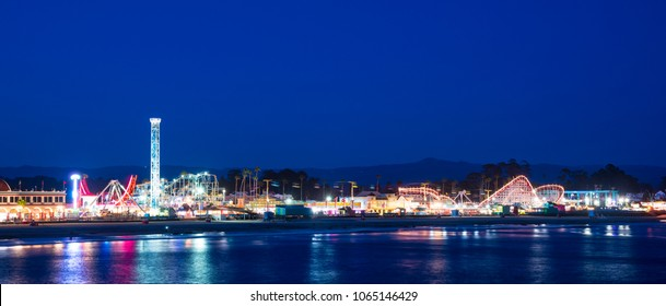 Panoramic view of amusement park on a beach at night