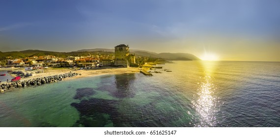 Panoramic view of a Ancient Athos, Ouranoupolis Tower on Athos peninsula in Halkidiki, Greece during sunset