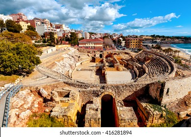a panoramic view of the ancient roman amphitheater of Tarragona, Spain, next to the Mediterranean sea