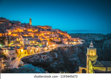 Panoramic view of the ancient town of Matera (Sassi di Matera) illuminated during beautiful evening twilight at dusk, Basilicata, southern Italy
