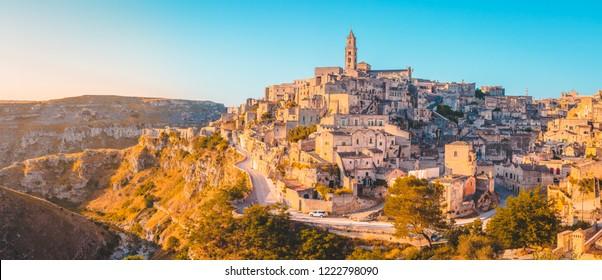 Panoramic view of the ancient town of Matera (Sassi di Matera) in beautiful golden morning light at sunrise, Basilicata, southern Italy