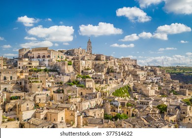 Panoramic view of the ancient town of Matera (Sassi di Matera), European Capital of Culture 2019, in beautiful golden morning light with blue sky and clouds, Basilicata, southern Italy