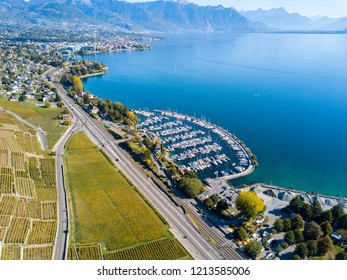 Panoramic view of ancient vineyards and Geneva Lake on in Lavaux, Switzerland. Vevey and Montreux resorts are in the background.