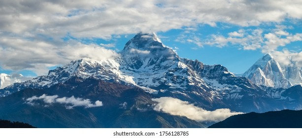 Panoramic view of Annapurna Mountain Range viewed from Pokhara city showing Mt. Fishtail or, Mt. Machchapuchhre, Himchuli and Annapurna mountains covered with snow.