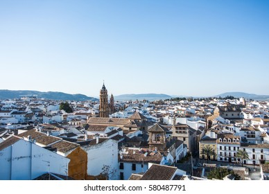 Panoramic view to Antequera old town and tower in the evening, Andalusia, Malaga province, Spain.