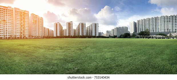 Panoramic view of Apartments on green grass field in Punggol District, Singapore, with sunlight filter effect