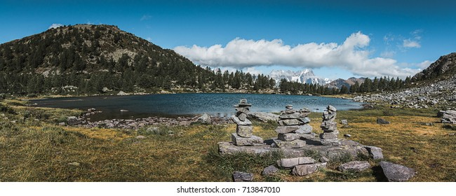 Panoramic view of the Arpy lake in Aosta Valley. In the background the White Mount (the highest mountain in europe). Cinematic tones.