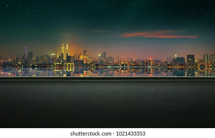 Panoramic view of asphalt road side with beautiful Kuala Lumpur city waterfront skyline. Night scene .