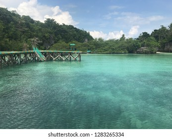 Panoramic view of Baer Island with blue watercolor beach in Kei Island, Indonesia