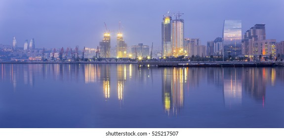 Panoramic view of Baku city, capital of Azerbaijan. Early morning in Baku bay. Seascape, cityscape.