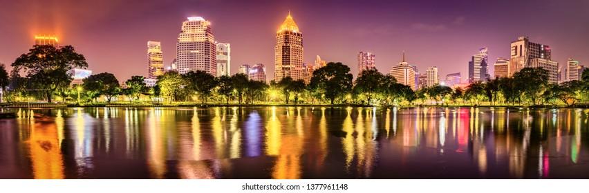 Panoramic view of Bangkok skyline. Night cityscape of Bangkok, Thailand. View from Lumphini park
