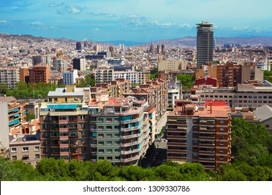 Panoramic view of Barcelona from the Mirador del Poble Sec, in a summer day. View on Sagrada Familia and the buildings of the city. Barcelona, Spain.