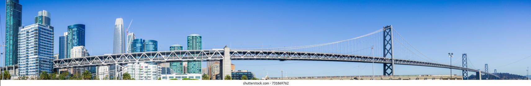 Panoramic view of the Bay Bridge spanning from the Financial District to Treasure Island on a sunny and clear day