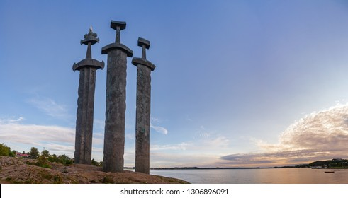 Panoramic view of Møllebukta bay with Swords in Rock (Sverd i fjell) monument, three large bronze swords planted into the rock commemorating the Battle of Hafrsfjord in 872 united Norway, Stavanger