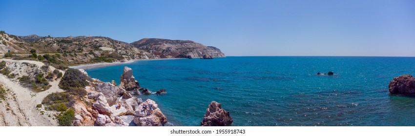 Panoramic view of the beach in the area of the Stone of Aphrodite. Petra tou Romiou, Cyprus