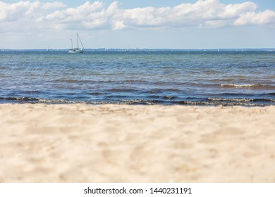 a panoramic view of the beach of the Baltic Sea with a sailing ship on the horizon