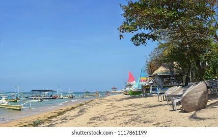 Panoramic view of Beach Chairs & Sailing Boats on Sanur Beach, Bali Indonesia