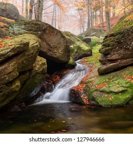 Panoramic view of a beautiful autumn waterfall.