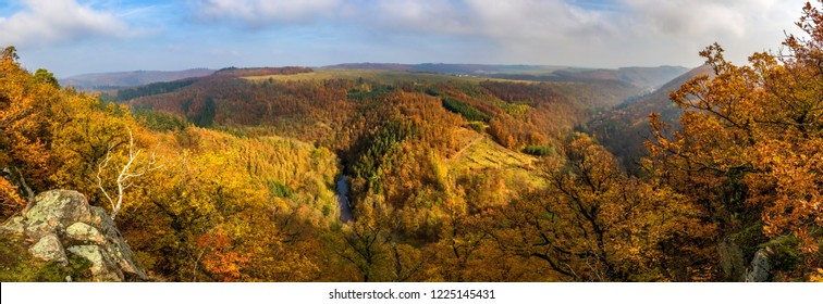 Panoramic view of beautiful autumnal landscape with river valley, colorful forests, blue sky and clouds - Oslava river, Czech Republic, Europe