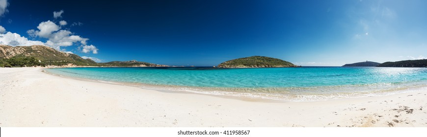 Panoramic view of a beautiful desert beach with white sand and clear sea. Sardinia Tuerredda beach