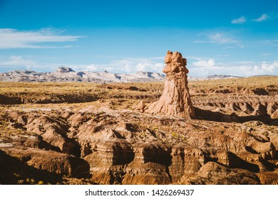 Panoramic view of beautiful desert landscape with hoodoos sandstone formations in Goblin Valley State Park in summer, Utah, USA