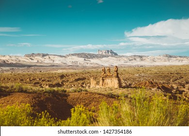 Panoramic view of beautiful desert landscape with hoodoos sandstone formations in Goblin Valley State Park at sunset, Utah, USA