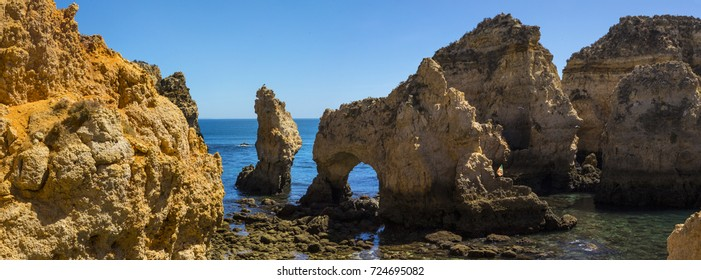 A panoramic view of the beautiful grotto and rock formations at Ponta da Piedade in the Algarve region of Portugal.