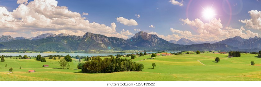 panoramic view to beautiful landscape in Bavaria with lake and mountains